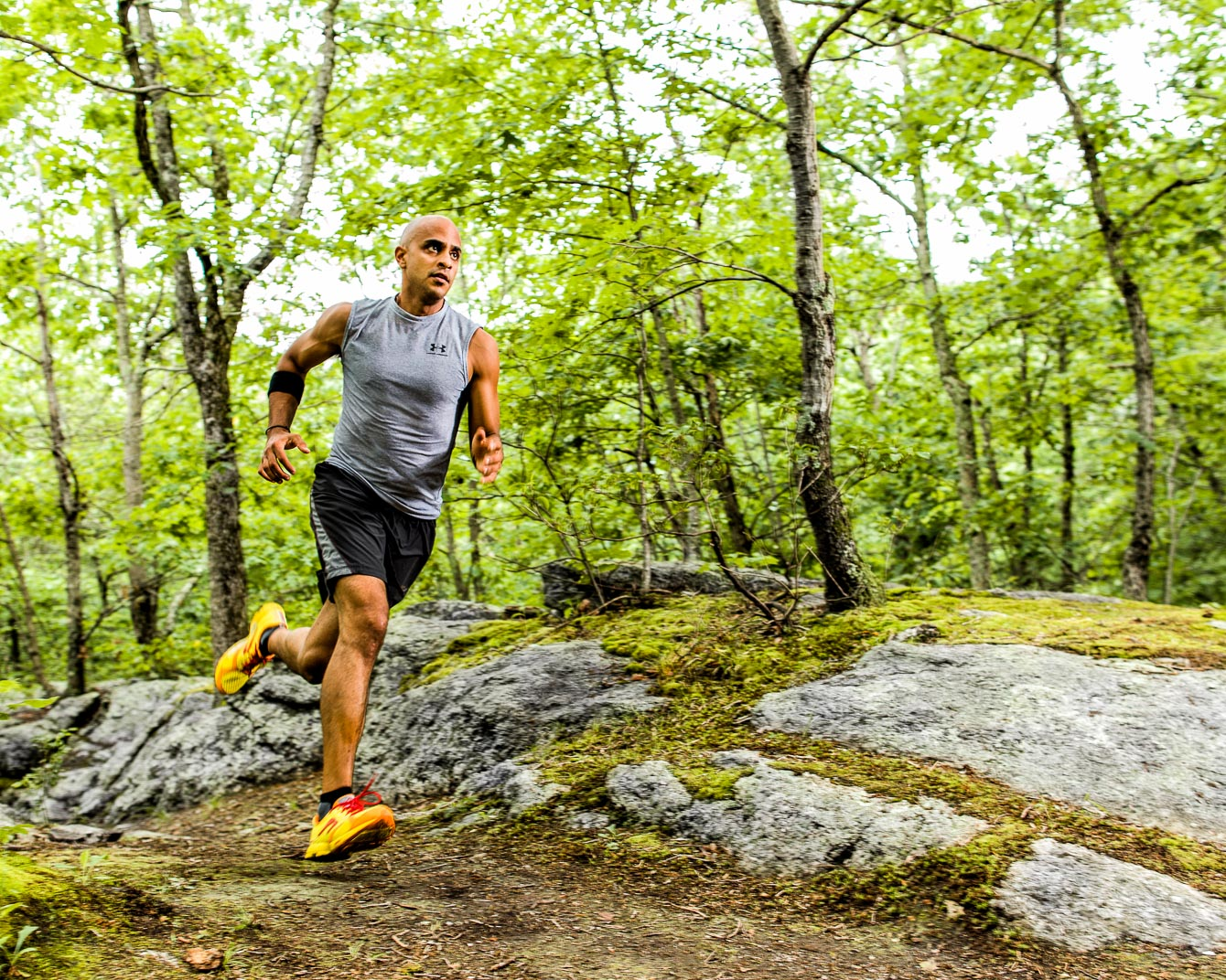 Atheletic Connecitcut man with Multiple Sclerosis runs through woods on trail