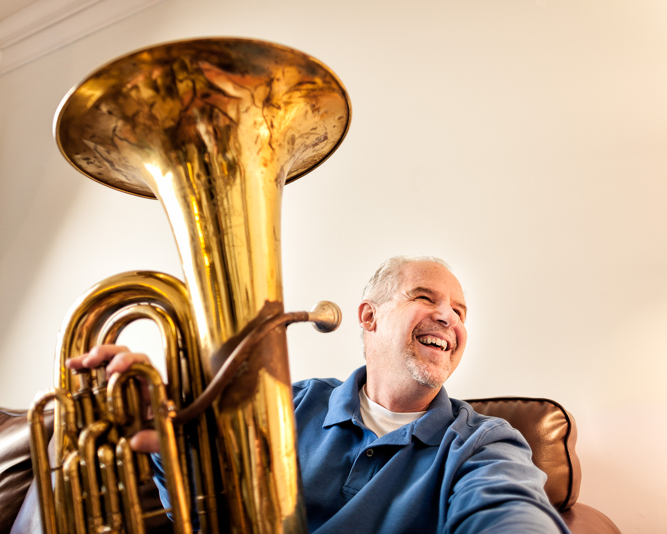 Connecticut man with Multiple Sclerosis smiling with trombone