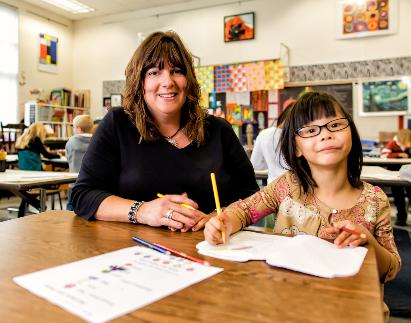 Connecticut woman with Multiple Sclerosis teaches young Asian girl in her classroom