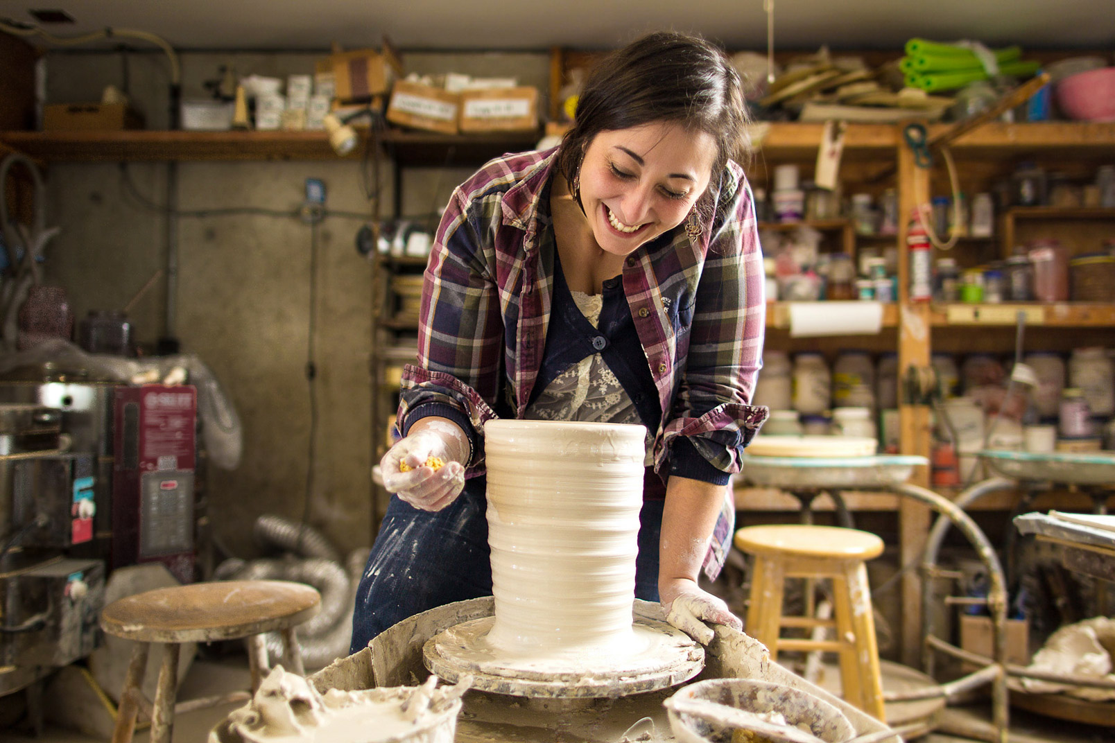 Connecticut woman  spinning clay on pottery wheel